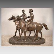 Small Cast Bronze Statue. Horses and Jockeys
