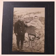 Photo of Children Baby in a Wicker Pram