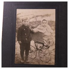Photo of Children Baby in a Wicker Pram