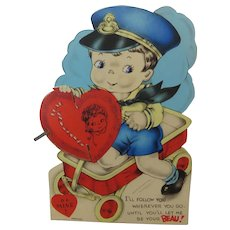 Valentine Little Boy On His Wagon Delivering a Honeycomb Heart