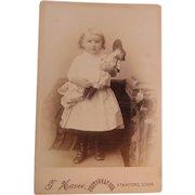 Cabinet Image Little Girl In Eyelet Dress Holding Her Doll