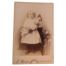 Cabinet Image Little Girl In Eyelet Dress Holding Her Doll
