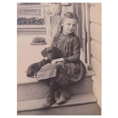 Effie Waterhouse Sitting on the Porch Petting Her Little Puppy