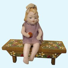Antique All-Bisque German Doll Seated on Bench