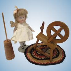 Vintage Wooden Spinning Wheel and Butter Churn