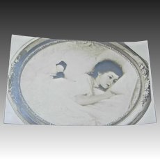 Photo Postcard Child sleeping with Boudoir/Bed Doll