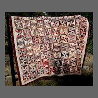 Falling Blocks on Star Pattern Quilt