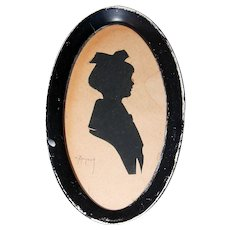 Young Child Silhouette in Oval Frame