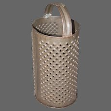 Cylinder Shaped Hand Held Grater