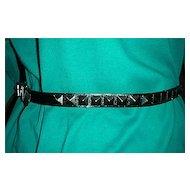 Black  leather belt w/ 3 D metal triangular ornamentation