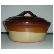 Covered brown individual stoneware casserole