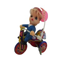 Vintage mechanical toy boy on   tricycle