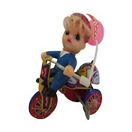 Vintage tin litho wind up toy boy on   tricycle w/tag