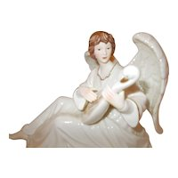 O'Well  Porcelain Angel playing swan lute