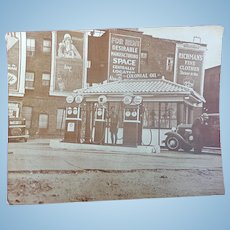 Photograph of an early Colonial Gas Station c.1930's
