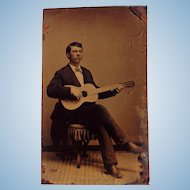 Tintype Photo of Young Man playing Antonio de Torres Guitar