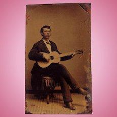 Tintype Photo of Young Man playing Antonio de Torres Guitar
