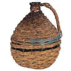 French Glass Demijohn Bottle in Woven Basket