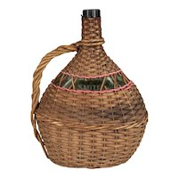 French Glass Bottle in Woven Basket