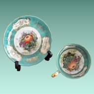 Ornate Footed Tea Cup and Saucer Set Teal Green Fruits Pattern