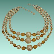 Three Stranded Necklace Signed Japan Amber and Pearl Color Beads
