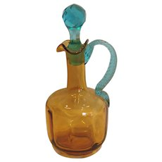 American Art Glass Cruet Amber Paneled Body Blue Rope Handle Diamond Faceted Stopper c 1910