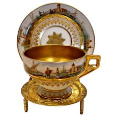 German Dresden Tiny Pedestal Demitasse Cup & Saucer Hand Painted Scenes Houses Boats People River Bridge Exceptional Gold Gilding c 1891-1900