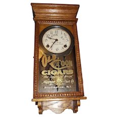 "Small Size ""Old Coon Cigars"" Advertising Clock in a refinished Golden Oak Case !!! Circa 1929-1940."