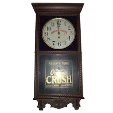 Ward's Orange Crush Advertiser Clock in a Store Regulator Model Clock Case made by The waterbury Clock Co. with an aged Oak Case Circa 1920's !