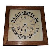 U.S.G. Harness Oil Advertising Clock in a Square Golden Oak Case.