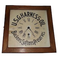 U.S.G. Harness Oil Advertising Clock in a Square Golden Oak Case.