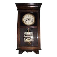 """Reed's Tonic"" Advertising Clock in a Half Size Store Regulator with a Dark Birch Finished Case Circa 1920's to 1940's !"