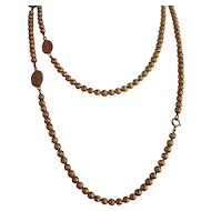 "Vintage extra long gold tone with round  beads and Flat beads - 50"" Signed Trifari necklace"