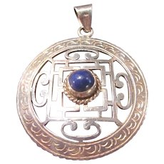 Vintage 925 sterling pendant with cutouts and blue lapis cabochon