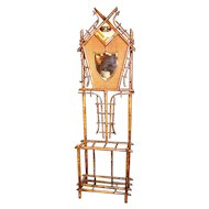 19th Century Art Nouveau Bamboo Woven Back Hall Tree With Beveled Shield Mirror and Nouveau Lamajolique - Societe Anonyme Tile