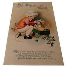 Antique Clapsaddle Christmas Postcard Child with wagon of toys
