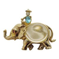 Vintage Adolph Katz for Coro 1950 Miniature Gold Tone Elephant Brooch with Clear Jelly Belly Cabochon and Blue Rhinestone Figural Rider
