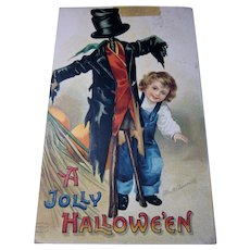 Vintage Clapsaddle Halloween Postcard Child with Scarecrow