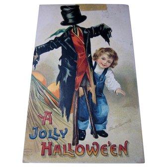 Vintage Clapsaddle Halloween Postcard Child with Scarecrow