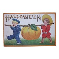 Vintage Halloween Postcard International Art Publishing Co. 1908 Beautiful Children bringing home giant pumpkin