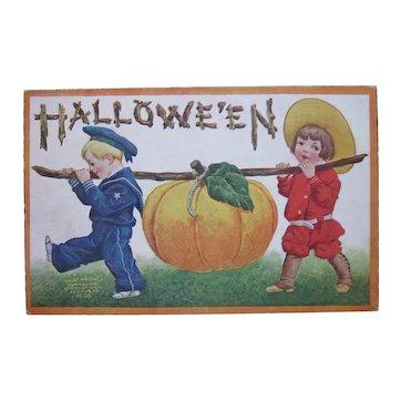 Vintage Halloween Postcard International Art Publishing Co. 1908 Beautiful Children bringing home giant pumpkin