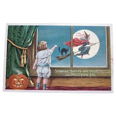 Vintage Halloween Postcard by Anglo American series 876/5  Child with JOL looking at flying Witch