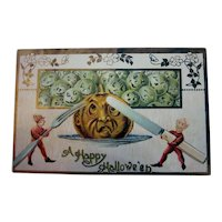 Vintage Halloween Postcard Imps Elves slicing into a pumpkin