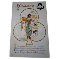 This is a vintage Halloween Nash Postcard H13 Witch with Black Cat, JOL, Magic Mirror, Bat