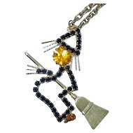 Vintage Rhinestone Halloween Witch on Broom Necklace black orange jewelry