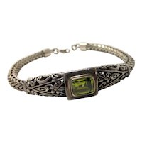 Sterling Silver Braided Rope Bracelet with Fleur de Lis Detail and Green Faceted Emerald Cut Glass