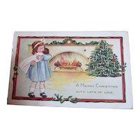 Vintage Christmas postcard Girl with doll baby