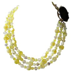 Vintage 1950s Triple Strand Yellow Aurora Borealis Glittering Glass Bead Statement Necklace with Oversize Black Glass Faceted Clasp