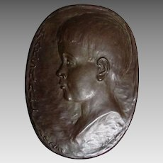 Charming Circa 1923 Bronze Plaque of a Little Boy, Signed