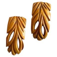 Pair of Deeply Carved Butterscotch Dress Clips Art Deco Era